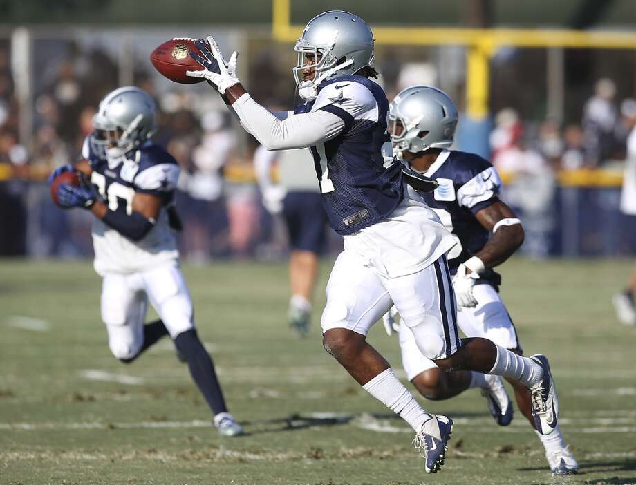 Safety J.J. Wilcox takes part in drills during the afternoon session of the 2013 Dallas Cowboys training camp on Saturday, July 27, 2013 in Oxnard. (Kin Man Hui/San Antonio Express-News) Photo: San Antonio Express-News