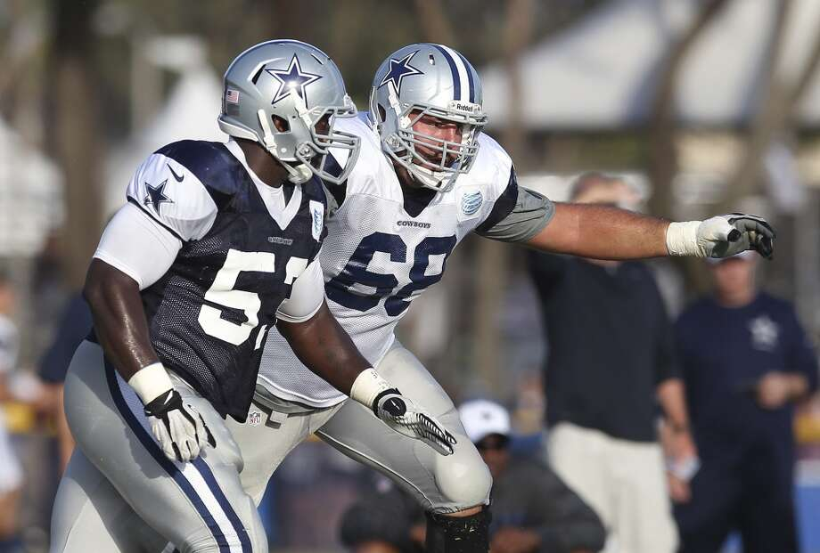 Tackle Doug Free (68) blocks defensive end Cameron Scheffield (53) during the afternoon session of the 2013 Dallas Cowboys training camp on Saturday, July 27, 2013 in Oxnard. (Kin Man Hui/San Antonio Express-News) Photo: San Antonio Express-News
