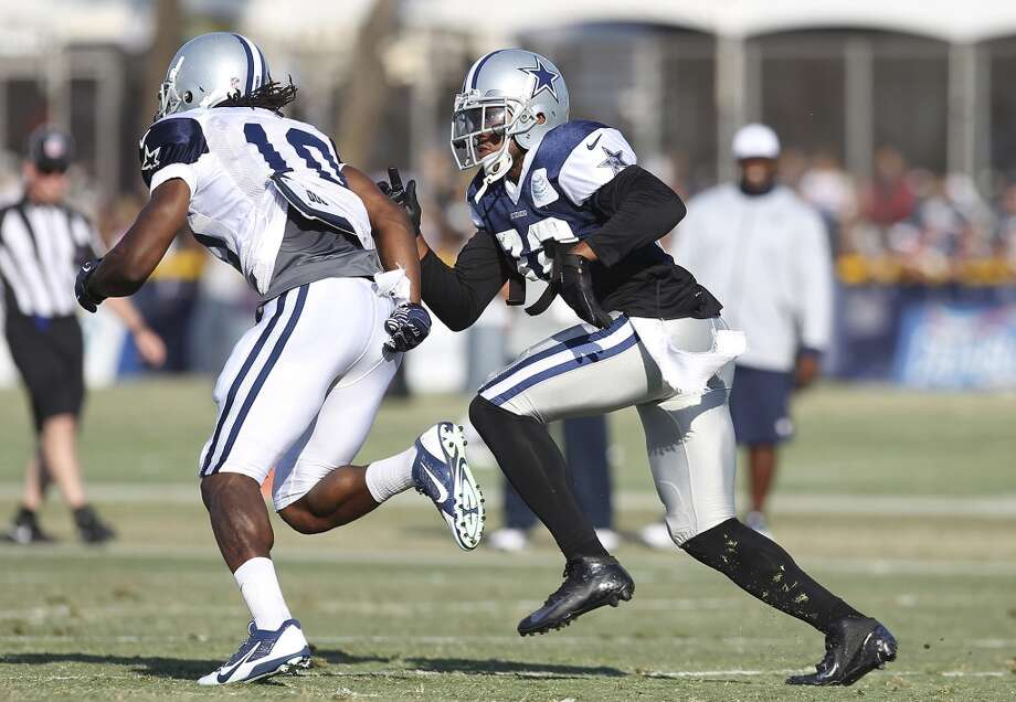 Cornerback Orlando Scandrick (32) pursues receiver Anthony Amos (10) during the afternoon session of the 2013 Dallas Cowboys training camp on Saturday, July 27, 2013 in Oxnard. (Kin Man Hui/San Antonio Express-News) Photo: San Antonio Express-News