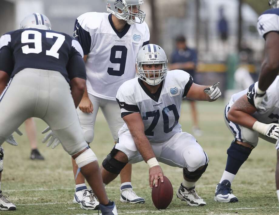 Center Travis Frederick (70) gestures toward the defense during the afternoon session of the 2013 Dallas Cowboys training camp on Saturday, July 27, 2013 in Oxnard. (Kin Man Hui/San Antonio Express-News) Photo: San Antonio Express-News