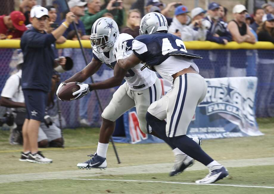 Running back Lance Dunbar (25) extends himself to the goal line against safety Barry Church (42) during the afternoon session of the 2013 Dallas Cowboys training camp on Saturday, July 27, 2013 in Oxnard. (Kin Man Hui/San Antonio Express-News) Photo: San Antonio Express-News
