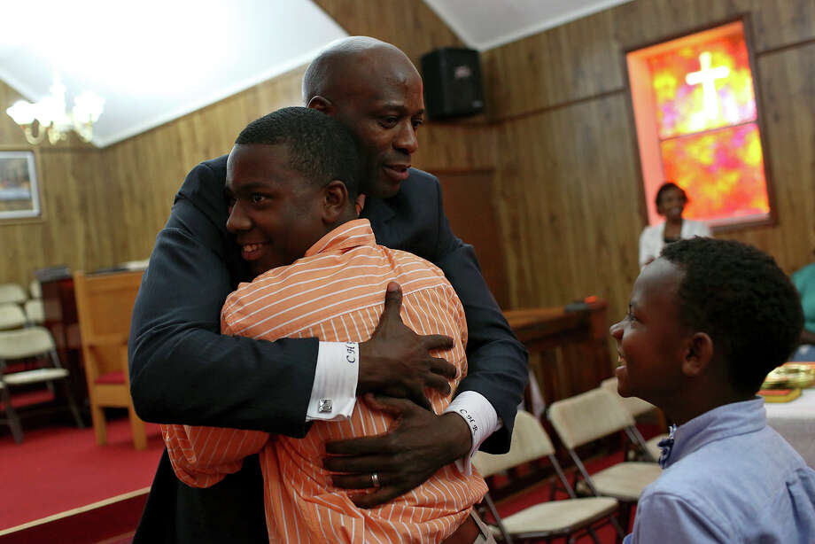 Chief Warrant Officer Christopher Royal embraces Xavier Levett, 15, after giving an inspirational talk for the Youth Day Celebration at Chapel United Methodist Church near his hometown of Eclectic, AL, on Sunday, July 14, 2013. Photo: Lisa Krantz, San Antonio Express-News / San Antonio Express-News