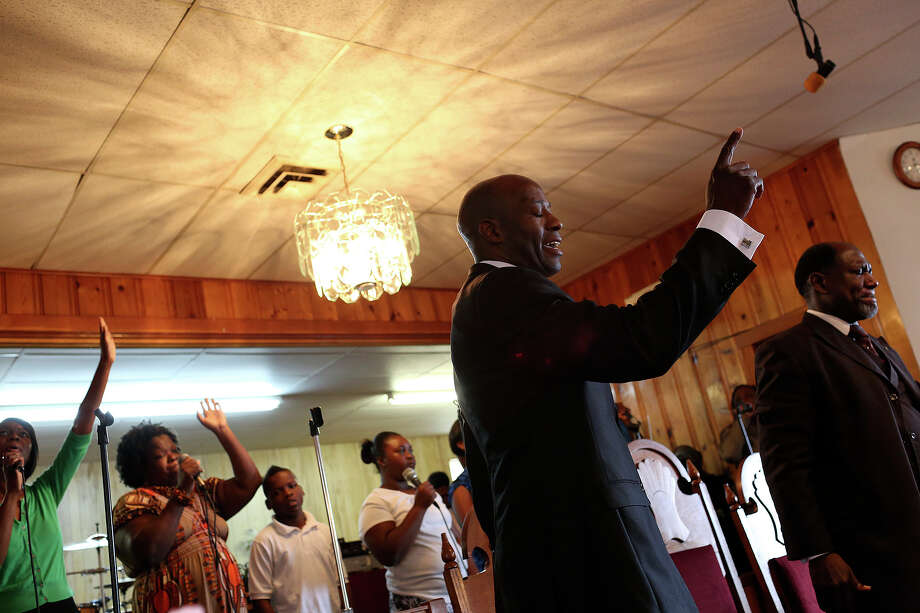 Chief Warrant Officer Christopher Royal sings with the choir before preaching at Macedonia Missionary Baptist Church in Goodwater, AL, near his hometown of Eclectic, AL, on Sunday, July 14, 2013. Photo: Lisa Krantz, San Antonio Express-News / San Antonio Express-News