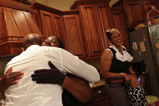 "Chief Warrant Officer Christopher Royal gets a hug from his ""Aunt Faye,"" Wilma Leonard, during a party for his retirement from the Army in his hometown of Eclectic, AL, on Saturday, July 13, 2013. Photo: Lisa Krantz, San Antonio Express-News / San Antonio Express-News"