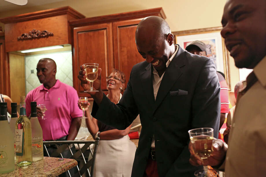 Chief Warrant Officer Christopher Royal laughs as a toast is given for him during a etirement party for him at his cousin's home in Eclectic, AL, on Saturday, July 13, 2013. Royal is being medically retired from the Army after 17 years of service including four tours in Iraq and one in Afghanistan. Photo: Lisa Krantz, San Antonio Express-News / San Antonio Express-News