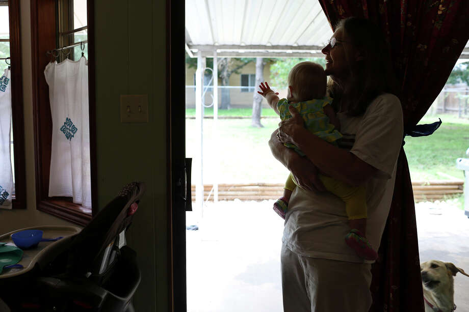 Joleen Cahill holds her granddaughter, Kate, 1, as she visits her daughter, Keely Cahill Vanacker, at their home in Kerrville on July 4, 2013. Photo: Lisa Krantz, San Antonio Express-News / San Antonio Express-News