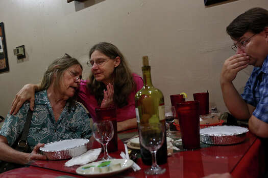 Joleen Cahill, center, spends her husband's birthday with their son, James, right, and a group of her closest friends including Carole Sparks, left, at Ginno's Italian Restaurant in Cameron on Tuesday, July 16, 2013. The group tries to have weekly get togethers. Photo: Lisa Krantz, San Antonio Express-News / San Antonio Express-News