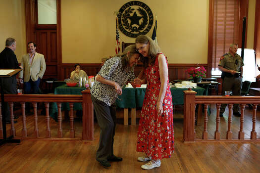 Joleen Cahill laughs with Carole Sparks during Cahill's retirement party at the Milam County Courthouse in Cameron on Tuesday, July 23, 2013. Cahill retired so she could attend the entire trial of Army Major Nidal Malik Hasan at Ft. Hood, the man who is being tried for killing her husband and 12 others, and to get the Ft. Hood November 5, 2009 Memorial built and spend more time with her family. Photo: Lisa Krantz, San Antonio Express-News / San Antonio Express-News
