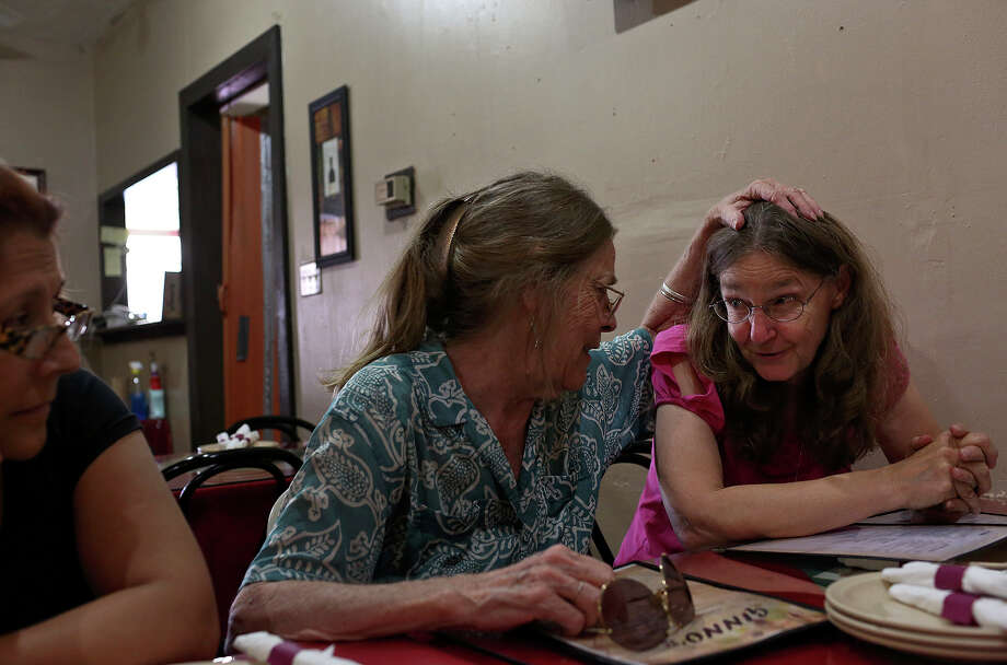Joleen Cahill, right, spends her husband's birthday with a group of her closest friends including Carole Sparks, center, and Liz Lewis, left, at Ginno's Italian Restaurant in Cameron on Tuesday, July 16, 2013. The group tries to have weekly get togethers. Photo: Lisa Krantz, San Antonio Express-News / San Antonio Express-News