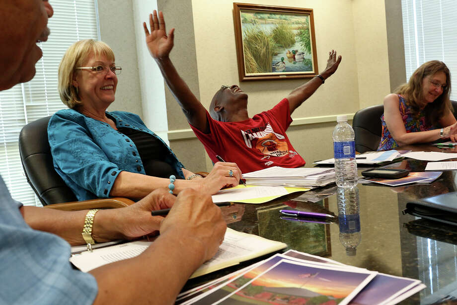 Joleen Cahill, far right, participates in a meeting of the Ft. Hood November 5, 2009 Memorial committee as they work to raise money and get the memorial built at the Killeen Convention Center on Tuesday, July 2, 2013. Photo: Lisa Krantz, San Antonio Express-News / San Antonio Express-News