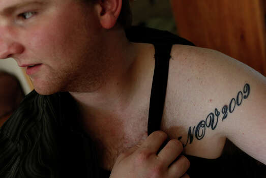 George Stratton III, 22, shows the tattoo he got after the Ft. Hood shootings under the bullet wound he suffered that day at his family's home in Post Falls, ID, on Friday, July 26, 2013. Photo: Lisa Krantz, San Antonio Express-News / San Antonio Express-News