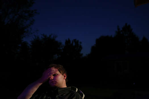 George Stratton III, 22, sits in the backyard as night falls at his family's home in Post Falls, ID, on Friday, July 26, 2013, his last night at home before driving to Wyoming with his father to work then to Killeen to testify in the trial of Major Nidal Malik Hasan, the man accused of shooting him. The shooting and the treatment he received after including prescription drugs, dramatically changed the course of his life and ended his military career. Photo: Lisa Krantz, San Antonio Express-News / San Antonio Express-News