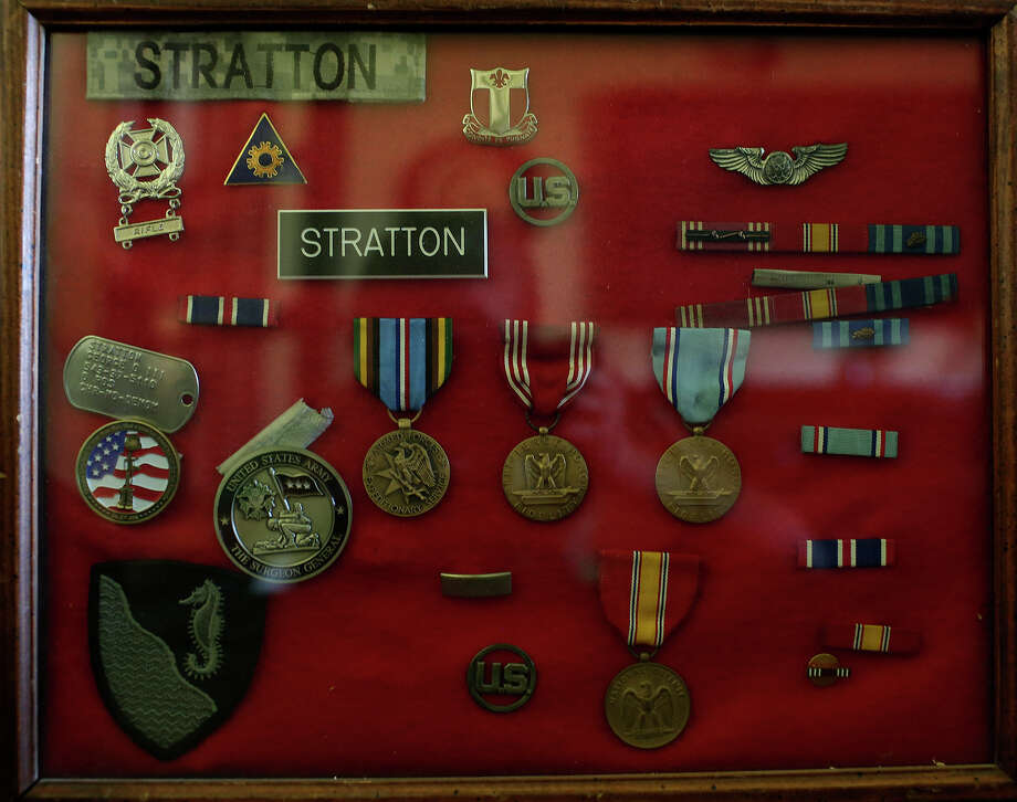 Awards and medals earned by George Stratton III and his grandfather, George Stratton, who was killed in Vietnam, are combined in a frame at the Stratton family home in Post Falls, ID, on Thursday, July 25, 2013. Photo: Lisa Krantz, San Antonio Express-News / San Antonio Express-News