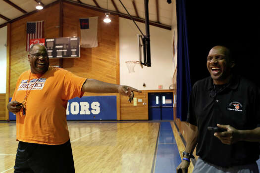 Coach Alonzo Lunsford, left, laughs with fellow coach Willie Dunbar during the summer basketball camp Lunsford leads at Fayetteville Christian Church on Saturday, July 20, 2013. Photo: Lisa Krantz, San Antonio Express-News / San Antonio Express-News
