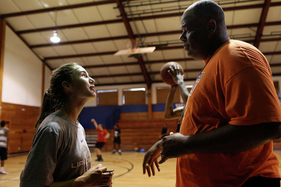 Alonzo Lunsford coaches Tiana Allen, 17, of Mooreville, MS, during his summer basketball camp at Fayetteville Christian School in Fayetteville, NC, on Saturday, July 20, 2013.  Lunsford is the school's associate head coach for women's basketball and the head coach for junior varsity. Photo: Lisa Krantz, San Antonio Express-News / San Antonio Express-News