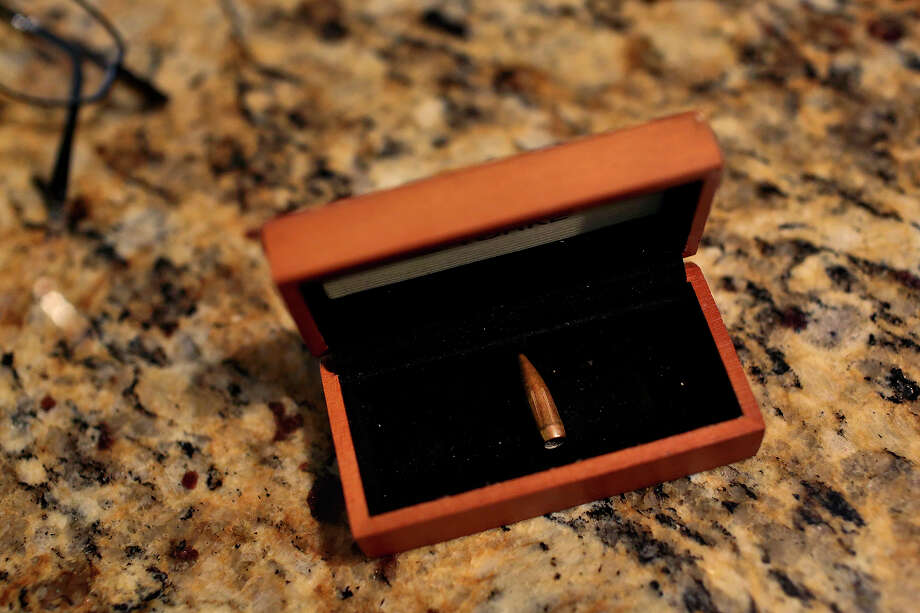 The seventh bullet, Alonzo Lunsford carries it with him everywhere he goes. The bullet was taken out recently when he found a lump on his side, not knowing what it was. He thought he had been shot six times but a previously undiscovered bullet had moved and made it's presence known. Photo: Lisa Krantz, San Antonio Express-News / San Antonio Express-News