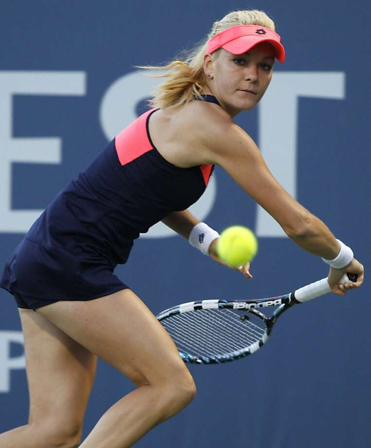Agnieszka Radwanska, of Poland, watches the ball before hitting a backhand against Jamie Hampton, of the United States, during a semifinal at the Bank of the West Tennis Classic, Saturday, July 27, 2013, in Stanford, Calif. Radwanska won 6-3, 6-2. (AP Photo/George Nikitin) Photo: George Nikitin, Associated Press