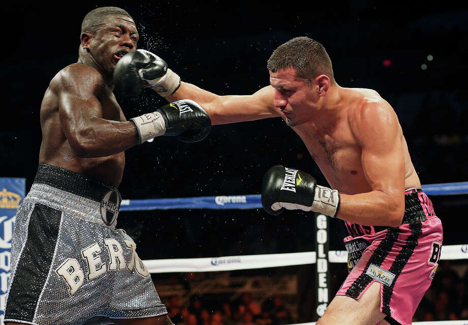 Jesus Soto Karass (pink trunks) battles Andre Berto and wins the title during the main event at the Knockout Kings II boxing card at the AT&T Center on July 27, 2013. Photo: TOM REEL, San Antonio Express-News