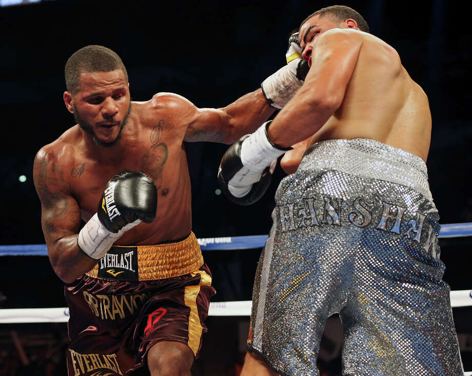 Anthony Dirrell cranks into the face of Anthony Hanshaw, stunning him and setting up his TKO win during the Knockout Kings II boxing card at the AT&T Center on July 27, 2013. Photo: TOM REEL, San Antonio Express-News