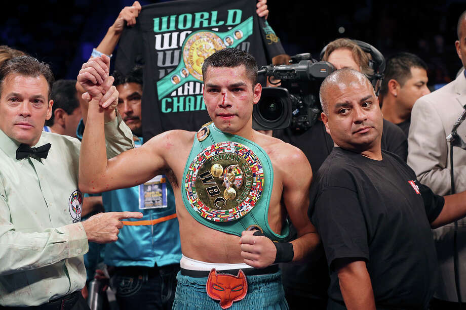 Omar Figueroa claims the title in his lightweight title bout against Nihito Arakawa during the Knockout Kings II boxing card at the AT&T Center on July 27, 2013. Photo: TOM REEL, San Antonio Express-News