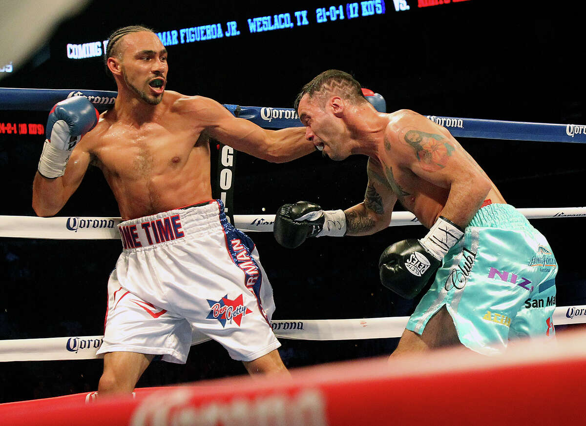 Keith Thurman takes a shot at Diego Chaves during the Knockout Kings II boxing card at the AT&T Center on July 27, 2013.