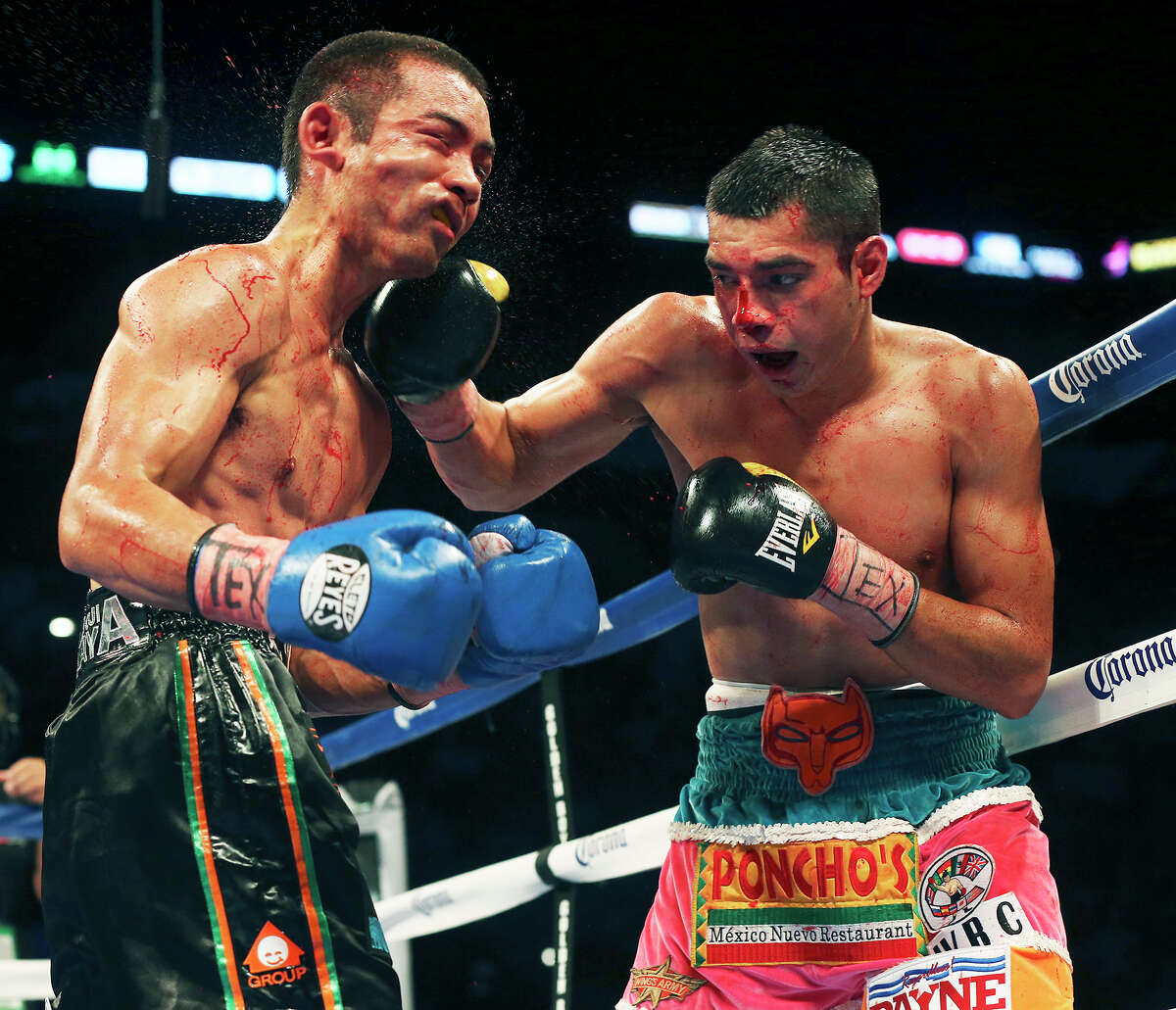 Omar Figueroa (right) battles Nihito Arakawa during the Knockout Kings II boxing card at the AT&T Center on July 27, 2013.