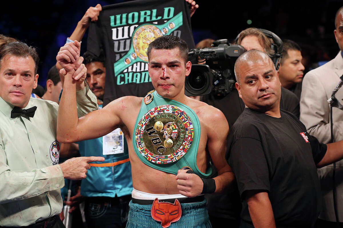 Omar Figueroa claims the title in his lightweight title bout against Nihito Arakawa during the Knockout Kings II boxing card at the AT&T Center on July 27, 2013.