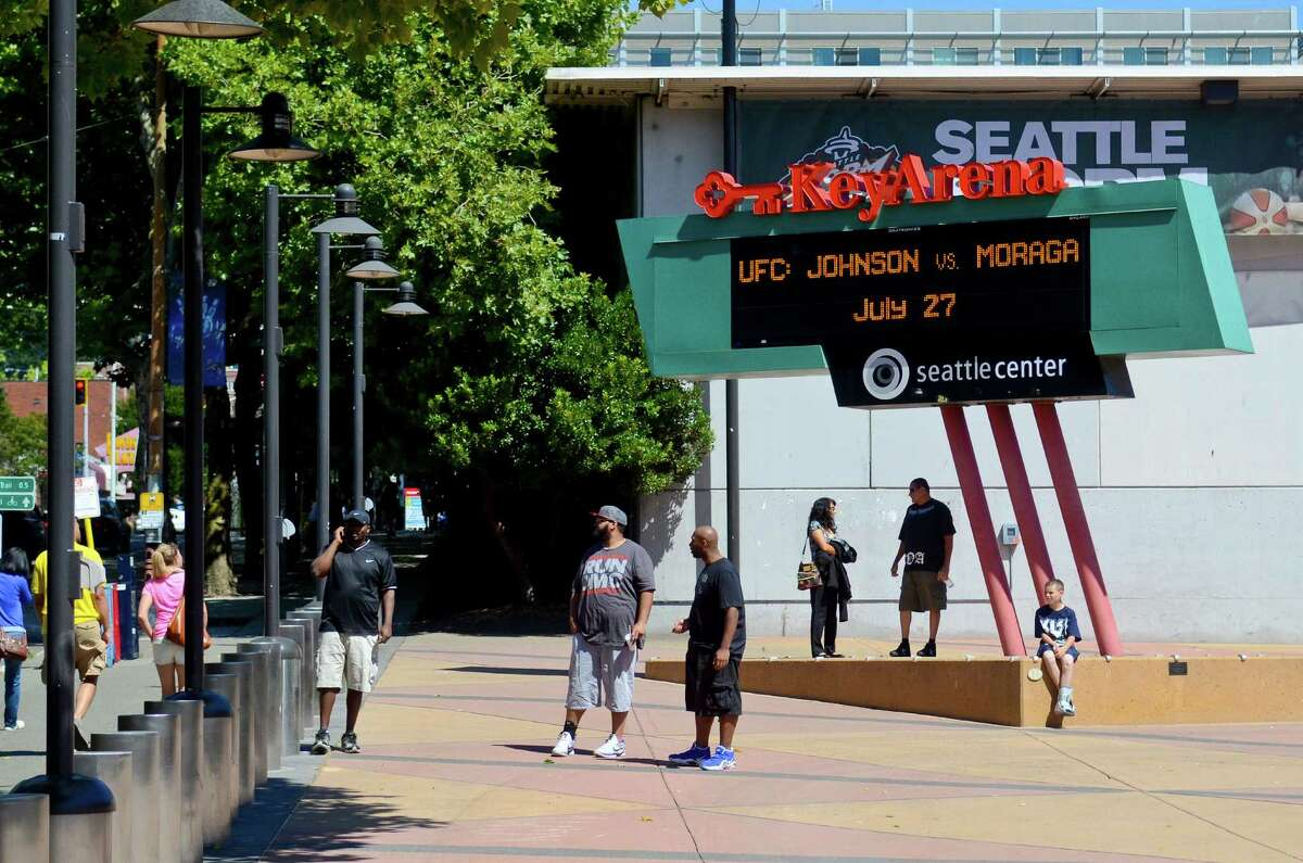 UFC fans wait outside the KeyArena, July 27, 2013, in Seattle.
