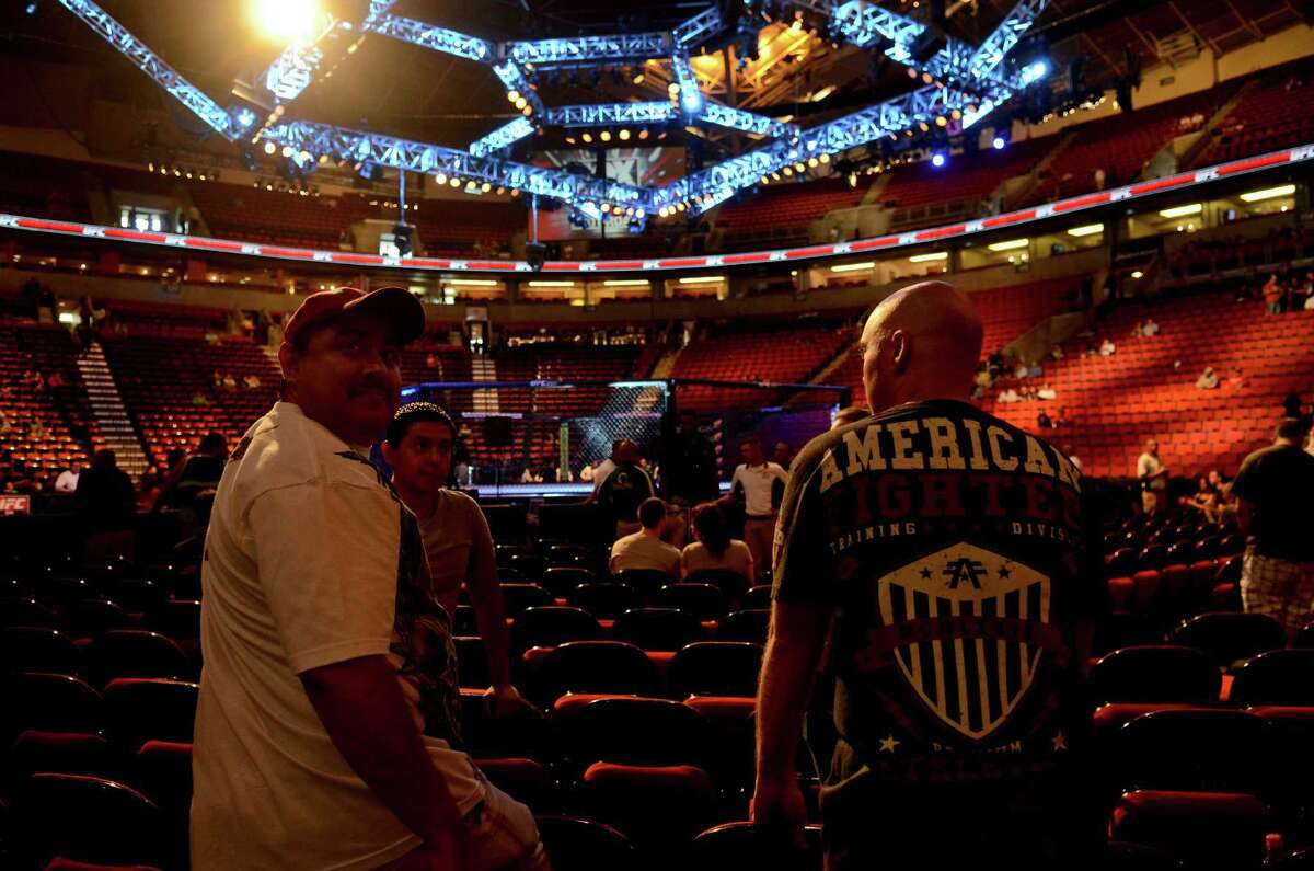 Franky Guerrez, left, and Robert Johnson, Right, wait for the UFC fights to start Saturday, July 27, 2013, at the KeyArena in Seattle.