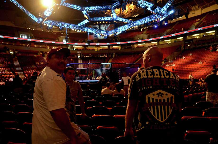 Franky Guerrez, left, and Robert Johnson, Right, wait for the UFC fights to start Saturday, July 27, 2013, at the KeyArena in Seattle. Photo: SY BEAN, SEATTLEPI.COM / SEATTLEPI.COM