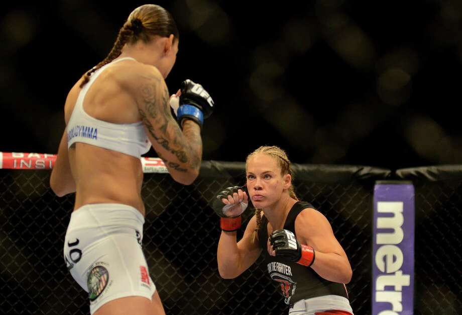 Julie Kedzie lost the fight against her opponent, Germaine de Randamie, Saturday, July 27, 2013, at the KeyArena in Seattle. Photo: SY BEAN, SEATTLEPI.COM / SEATTLEPI.COM