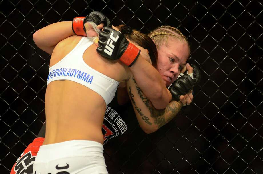 Germaine de Randamie has her opponent Julie Kedzie in a hold Saturday, July 27, 2013, at the KeyArena in Seattle. Kedzie lost the fight. Photo: SY BEAN, SEATTLEPI.COM / SEATTLEPI.COM