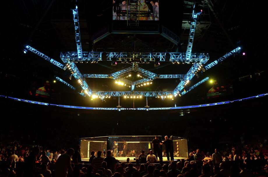 The crowd cheers as they wait for Demetrious Johnson and John Moraga to fight for the Flyweight Championship Saturday, July 27, 2013, at the KeyArena in Seattle. Photo: SY BEAN, SEATTLEPI.COM / SEATTLEPI.COM