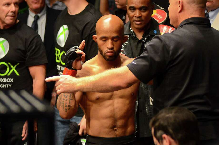 Demetrious Johnson of Parkland, Washington, prepares to fight John Moraga of Phoenix, Arizona, Saturday, July 27, 2013, at the KeyArena in Seattle. Johnson won the fight, keeping his Championship title. Photo: SY BEAN, SEATTLEPI.COM / SEATTLEPI.COM