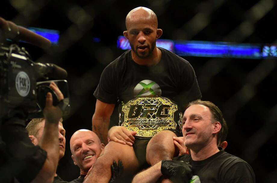 Demetrious Johnson of Parkland, Washington, wins the Championship fight against John Moraga of Phoenix, Arizona, to keep his title of Flyweight Champion Saturday, July 27, 2013, at the KeyArena in Seattle. Photo: SY BEAN, SEATTLEPI.COM / SEATTLEPI.COM
