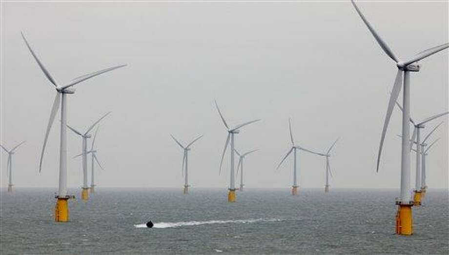A small boat passes through the windmills of the Thanet Offshore Wind Farm off the coast of Ramsgate in Kent, England. It officially opened in 2010 as the world's largest site of its type. Photo: Gareth Fuller, AP / PA