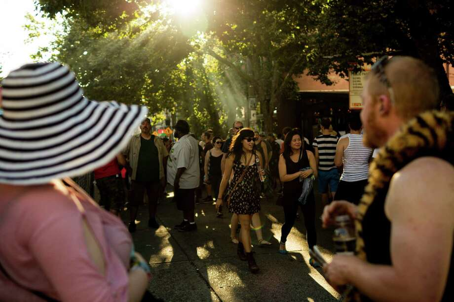 Thousands crowd East Pike Street during the second day of Capitol Hill Block Party Saturday, July 27, 2013, in the Capitol Hill neighborhood of Seattle. The festival continues Sunday. Photo: JORDAN STEAD, SEATTLEPI.COM / SEATTLEPI.COM