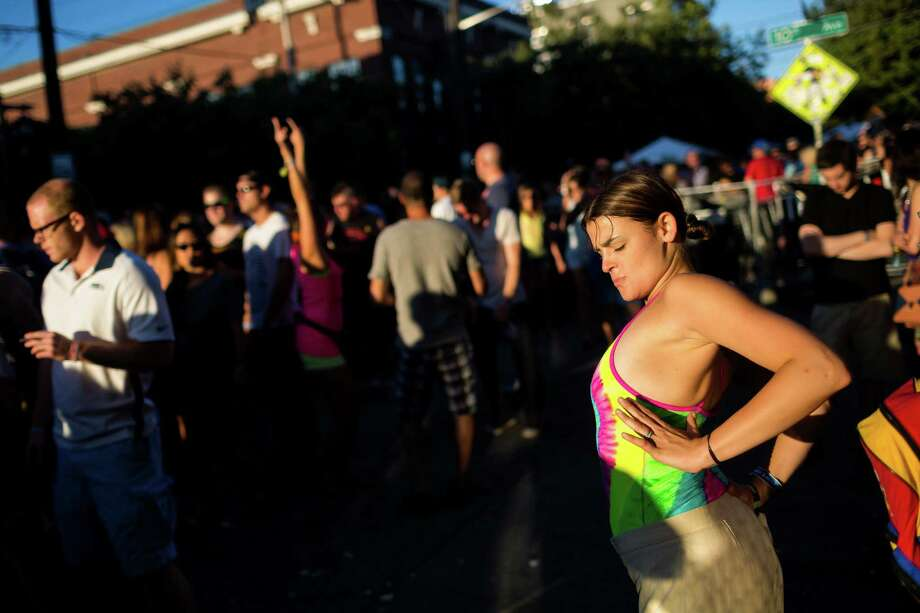 Michelle Avery, 25, right, dances to A Trak on the second day of Capitol Hill Block Party Saturday, July 27, 2013, in the Capitol Hill neighborhood of Seattle. The festival continues Sunday. Photo: JORDAN STEAD, SEATTLEPI.COM / SEATTLEPI.COM