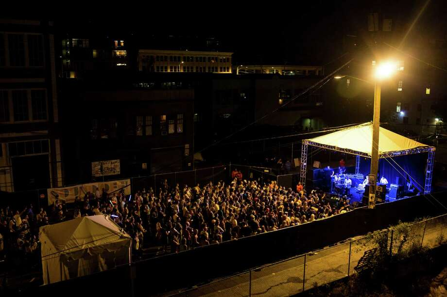 A crowd gathers later in the evening to enjoy a band on the second day of Capitol Hill Block Party Saturday, July 27, 2013, in the Capitol Hill neighborhood of Seattle. The festival continues Sunday. Photo: JORDAN STEAD, SEATTLEPI.COM / SEATTLEPI.COM