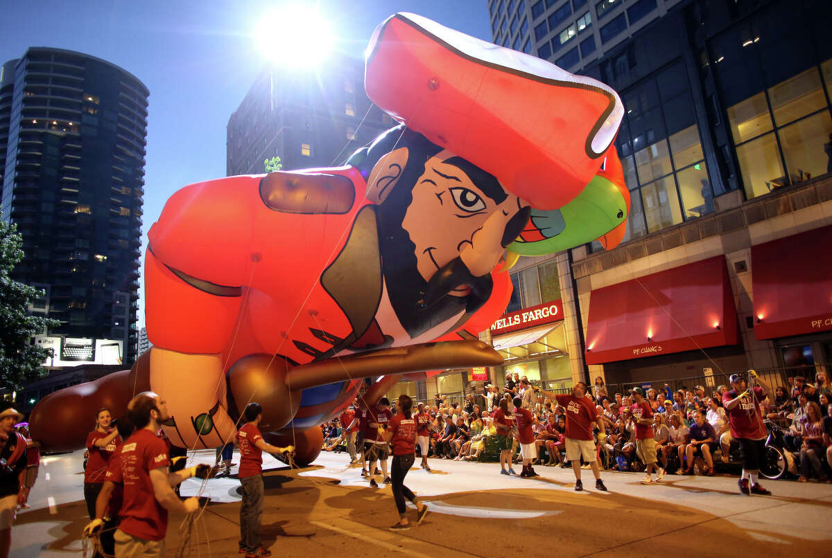 An inflatable pirate makes his way along the route during the annual Seafair Torchlight Parade on Saturday, July 27, 2013 in downtown Seattle. Fourth Avenue was lined with thousands of people during the parade that featured 106 entries.