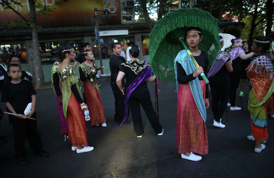 Filipino performs wait to march during the annual Seafair Torchlight Parade on Saturday, July 27, 2013 in downtown Seattle. Fourth Avenue was lined with thousands of people during the parade that featured 106 entries. Photo: JOSHUA TRUJILLO, SEATTLEPI.COM / SEATTLEPI.COM