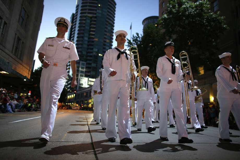 Members of the U.S. Navy band perform during the annual Seafair Torchlight Parade on Saturday, July 27, 2013 in downtown Seattle. Fourth Avenue was lined with thousands of people during the parade that featured 106 entries. Photo: JOSHUA TRUJILLO, SEATTLEPI.COM / SEATTLEPI.COM