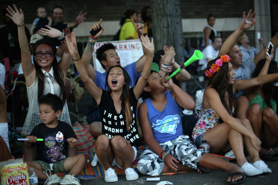 Spectators cheer during the annual Seafair Torchlight Parade on Saturday, July 27, 2013 in downtown Seattle. Fourth Avenue was lined with thousands of people during the parade that featured 106 entries. Photo: JOSHUA TRUJILLO, SEATTLEPI.COM / SEATTLEPI.COM