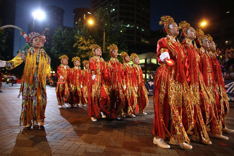 Members of the Chinese Drill Team perform during the annual Seafair Torchlight Parade on Saturday, July 27, 2013 in downtown Seattle. Fourth Avenue was lined with thousands of people during the parade that featured 106 entries. Photo: JOSHUA TRUJILLO, SEATTLEPI.COM / SEATTLEPI.COM