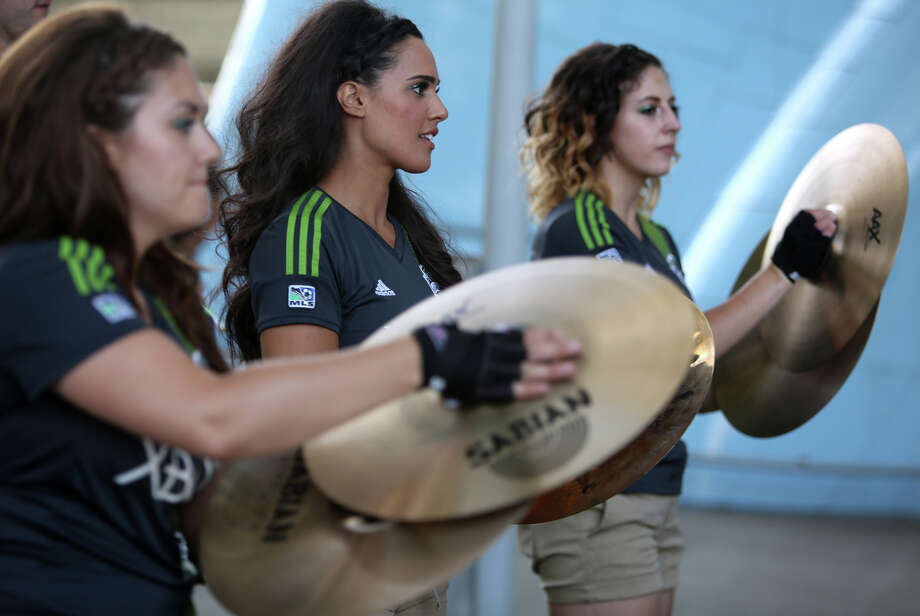 Members of the Sounders band Soundwave perform during the annual Seafair Torchlight Parade on Saturday, July 27, 2013 in downtown Seattle. Fourth Avenue was lined with thousands of people during the parade that featured 106 entries. Photo: JOSHUA TRUJILLO, SEATTLEPI.COM / SEATTLEPI.COM