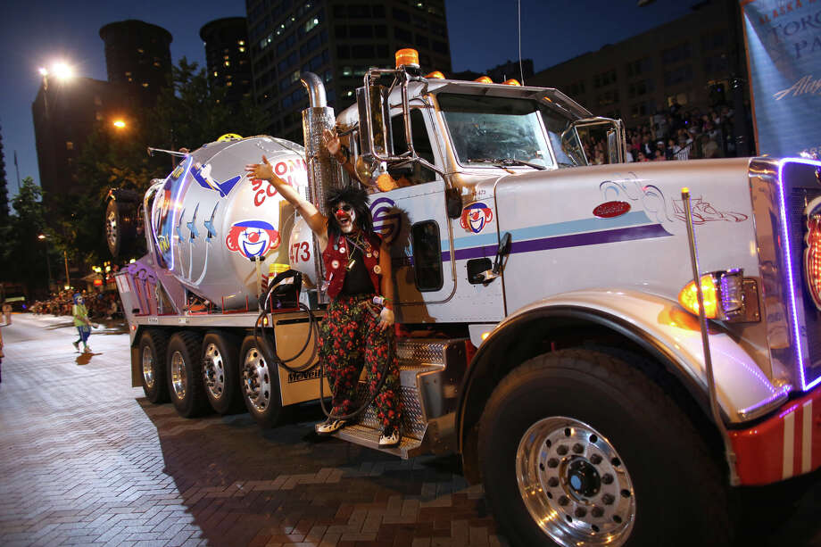 The Seafair Clowns ride on a cement mixer during the annual Seafair Torchlight Parade on Saturday, July 27, 2013 in downtown Seattle. Fourth Avenue was lined with thousands of people during the parade that featured 106 entries. Photo: JOSHUA TRUJILLO, SEATTLEPI.COM / SEATTLEPI.COM