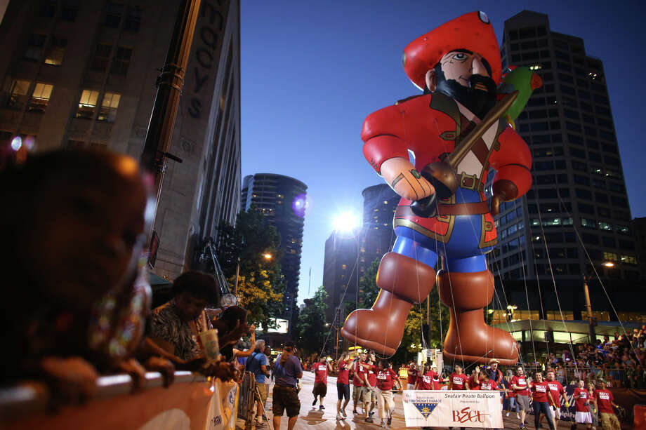 An inflatable pirate makes his way along the route during the annual Seafair Torchlight Parade on Saturday, July 27, 2013 in downtown Seattle. Fourth Avenue was lined with thousands of people during the parade that featured 106 entries. Photo: JOSHUA TRUJILLO, SEATTLEPI.COM / SEATTLEPI.COM