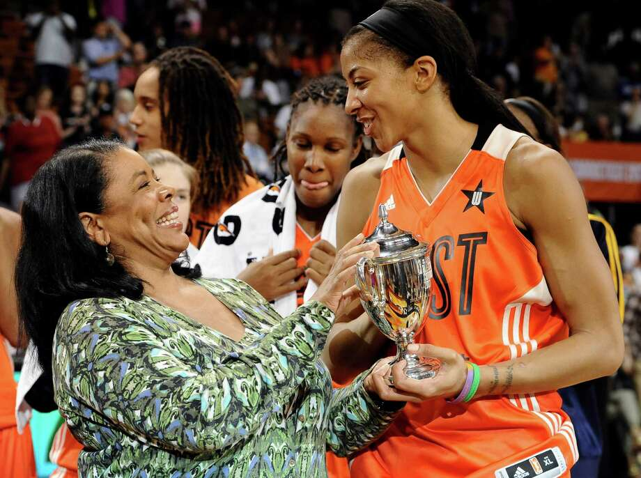 West's Candace Parker, right, of the Los Angeles Sparks, receives the MVP trophy from WNBA President Laurel Richie after the WNBA All-Star basketball game in Uncasville, Conn., Saturday, July 27, 2013. The West won 102-98. Photo: Jessica Hill
