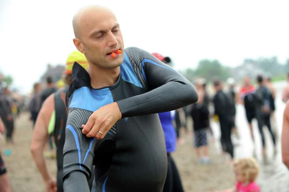 Navid Pourmorad, of Great Neck, N.Y., gets ready for the Betteridge Greenwich Cup Triathlon at Greenwich Point, in Old Greenwich, Conn., Sunday, July 28, 2013. Photo: Helen Neafsey / Greenwich Time