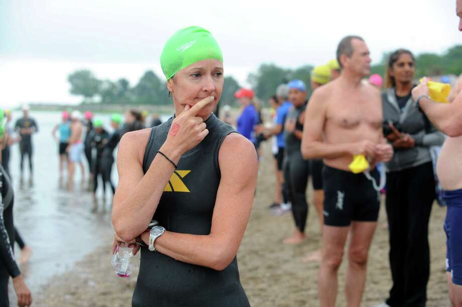 Betsy Monroe, of Rye, N.Y., gets ready at the Betteridge Greenwich Cup Triathlon at Greenwich Point, in Old Greenwich, Conn., Sunday, July 28, 2013. Photo: Helen Neafsey / Greenwich Time